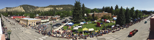 This is a panoramic view of Meeker's Range Call Parade, held Monday morning along Main Street in the downtown area. The parade ran from 7th Street to 4th Street, and this photo, taken using an iPhone, views the entire length of the parade route. One can see the beginning of the parade lineup at the far right nearing the end of the route, all the way to the end of the lineup at the far left. In between, the intersection of 7th and Main streets, and all of the vendors, booths, games and crowd lined up in front of the Rio Blanco County Courthouse. Crowds lined both streets to enjoy the spectacle, which featured a record number of entries this year.
