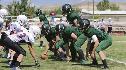 Rangely's Junior High football team lines up against Soroco during last Friday's game.  The team won the game 36-6.