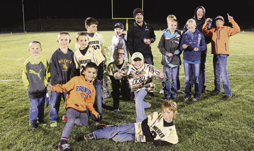 NFL Punt, Pass & Kick participants from ages 6-15 competed against their peers. Winners can attend the sectional event in Grand Junction Oct. 23. Pictured are Finley Deming, lying down; Said Valeriano, kneeling; Bryce Barth, Dillon Hobbs; Dexter Chinn, Tucker Chinn, Snowden Williams, Hayden Shults, Ethan Quinn, ERBM recreation assistant Mike Pfister, Madison Mendenhall, John Hampton Hightower, Autumn Hobbs, Ryan Phelan and Liam Deming, standing.
