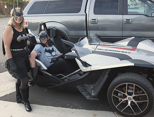 Kim Brown and 'Ted' Tedford took their costumes to the next level, arriving at the Gala in their Bat-style conveyance