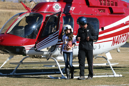 "Meeker High School freshman Kirstin Brown scored a perfect 850 on the standardized Math Map PARCC test. Brown was honored when local police officer Gardner Mendenhall, also a flight paramedic for Classic Air Medical—Search and Rescue out of Steamboat Springs, arranged for Brown to ride in the helicopter to mid-field in Starbuck Stadium where she delivered the game ball for the semifinal game between the Meeker Cowboys and Bennett Tigers. Brown's older brother caught the go-ahead touchdown pass. ""The ride was a lot of fun and my brother had a great game,"" Brown said. ""l was proud to wear his jersey. I put the magic touch on the ball."" Dwight Siverson photo"