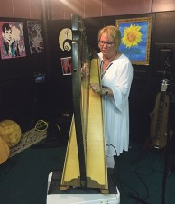 Kim McKee performs Celtic music at Smoking River Arts on a harp made from Scottish sycamore wood. Pat Turner