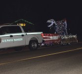 Even the dinosaurs were feeling festive at the Parade of Lights on Saturday. RENÉ HARDEN photo