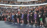 The lights are turned down in the Pepsi Center during the Parade of Champions, which featured Meeker Cowboys Jacob Pelloni and Tannen Kennedy, along with their coaches J.C. Watt and Tyrell Turner.
