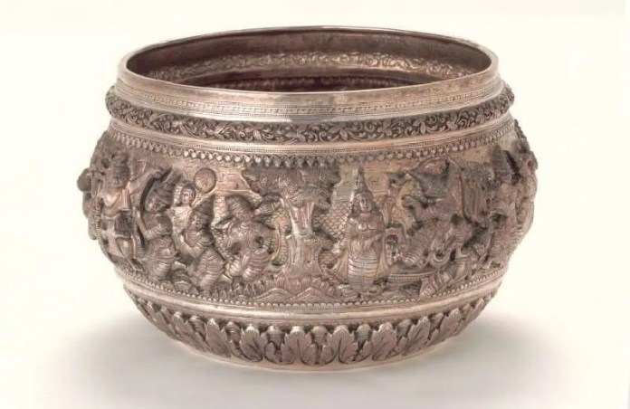 Ramayana on the Bowl : The elaborate decoration on these bowls includes scenes from the Burmese Ramayana tradition. The repoussee technique in which designs are beaten into the sheet silver,produces avivid portrayal inhigh relief of the characters, whose costumesand masks point to theinfluence of the Than khon dance-drama. This was one of the influences on burmese tellings of the ramayana and is thought to have been adaptedafter the Burmese sacking of the Thai royalcapital of Ayutthaya in 1767. Credit: Asian Civilisations Museum