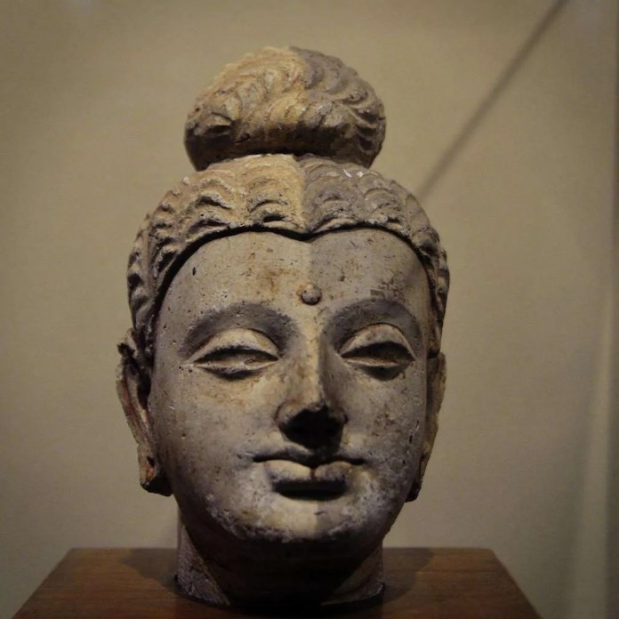 Half of a 1,500 year old stucco Buddha head was cleaned with pulses of laser light.