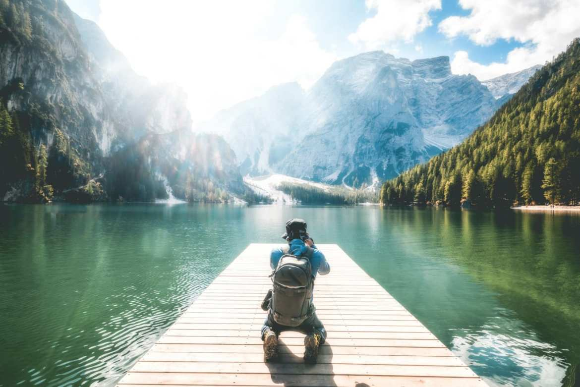 Traveler Taking Photo Of Lake Braies In Italy.
