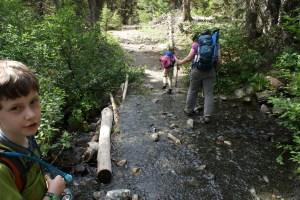 kids hiking crossing stream esmerelda basin trail teanaway