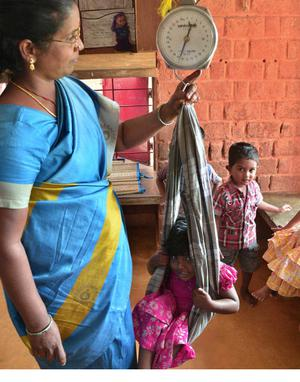 Image result for children being weighed india anganwadi