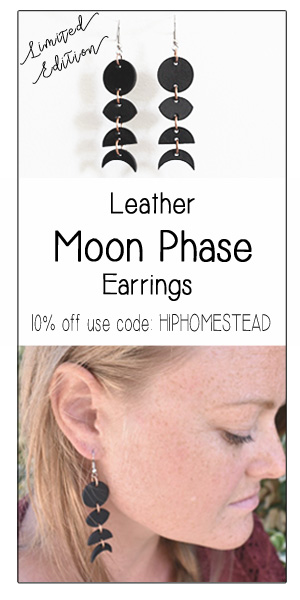 woman wearing black leather moon phase earrings