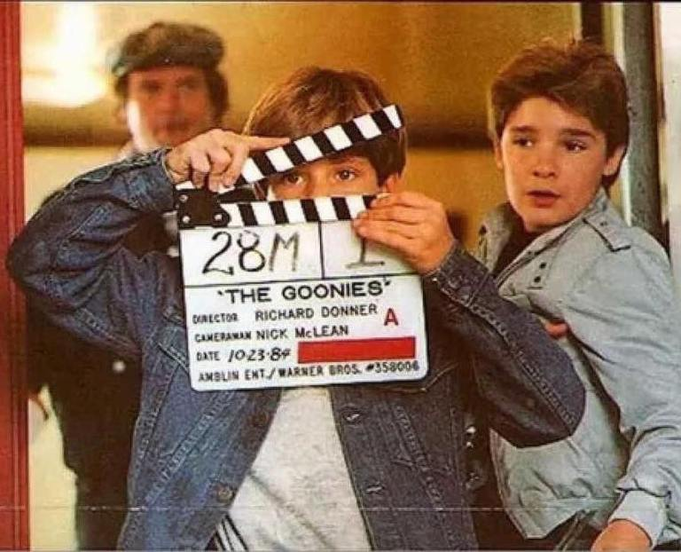 "Sean Astin and Corey Feldman preparing for a scene in ""The Goonies"" (1985). Movie was directed by Richard Donner. Story by Steven Spielberg and screenplay by Chris Columbus"