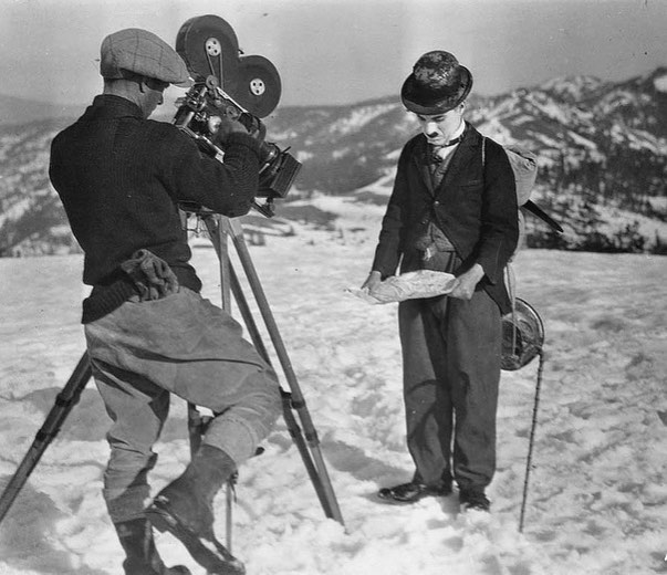 Charles Chaplin behind the scenes of 'The Gold Rush' (1925). Charles wrote, directed, produced and starred the production.