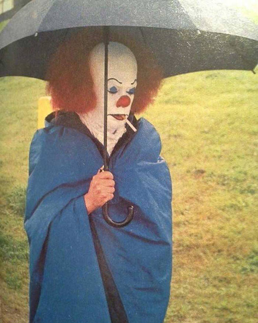Tim Curry smoking a cigarette behind the scenes on the set of 'IT' (1990)