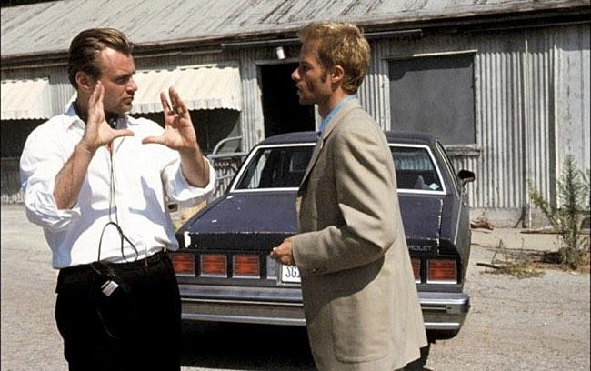 Director Christopher Nolan and Guy Pearce behind the scenes of the outstanding 'Memento' (2000)