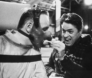 Director Jonathan Demme gives a snack to Sir Anthony Hopkins on the set of