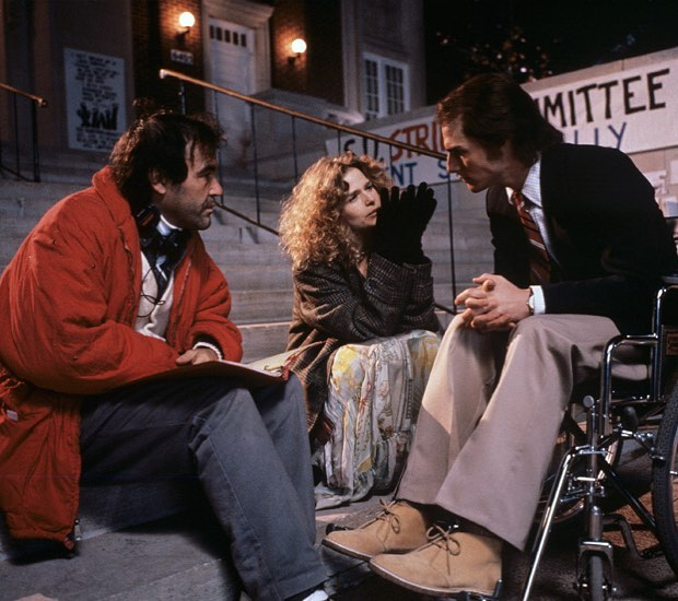 """Tom Cruise with his Oscar-nominated performance in """"Born on the Fourth of July"""" (1989) with director Oliver Stone and co-star Kyra Sedgwick."""