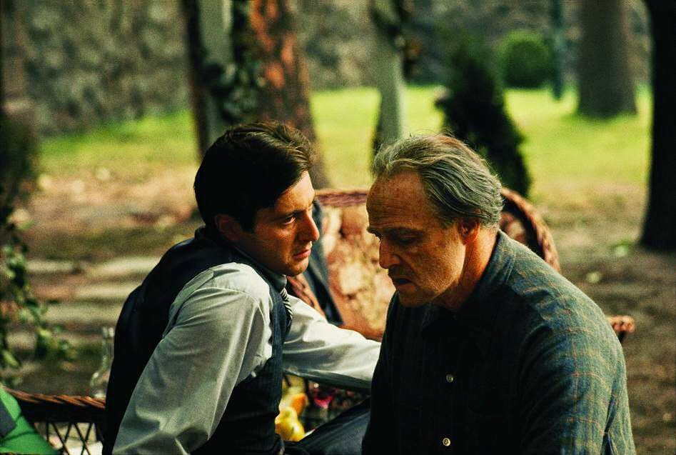 "Did you know?! In the first film, The Italian-American Civil Rights League requested that ""Mafia"" and ""Cosa Nostra"" be removed from the film's script. Francis Ford Coppola accepted and these words were never mentioned in the movie. In the photo: Al Pacino and Marlon Brando in a scene of 'The Godfather' (1972)"