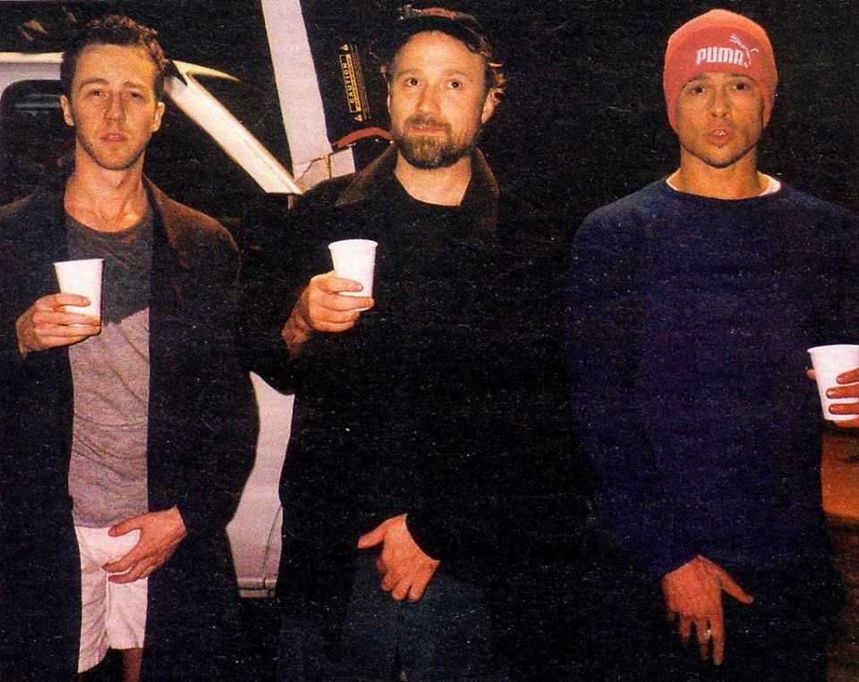 "Did you know?! In the very first fight scene, Edward Norton really did hit Brad Pitt? Fincher took Norton aside and whispered to him that he should hit Pitt –without any warning– in the ear. Pitt's surprised and pained reaction (""You hit me in the ear!"") is real! On the photo: Edward Norton, David Fincher and Brad Pitt behind the scenes of ""Fight Club"" (1999)"