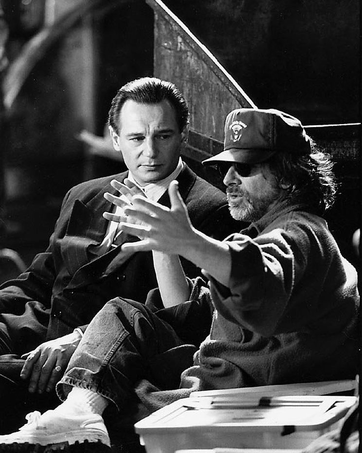 Director Steven Spielberg and Liam Neeson behind the scenes of the amazing