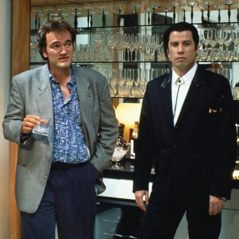 Director Quentin Tarantino and John Travolta behind the scenes of