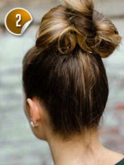cute with bun and bow hairstyle