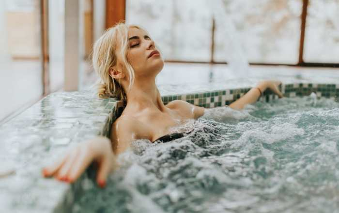 Young woman relaxing in hot tub