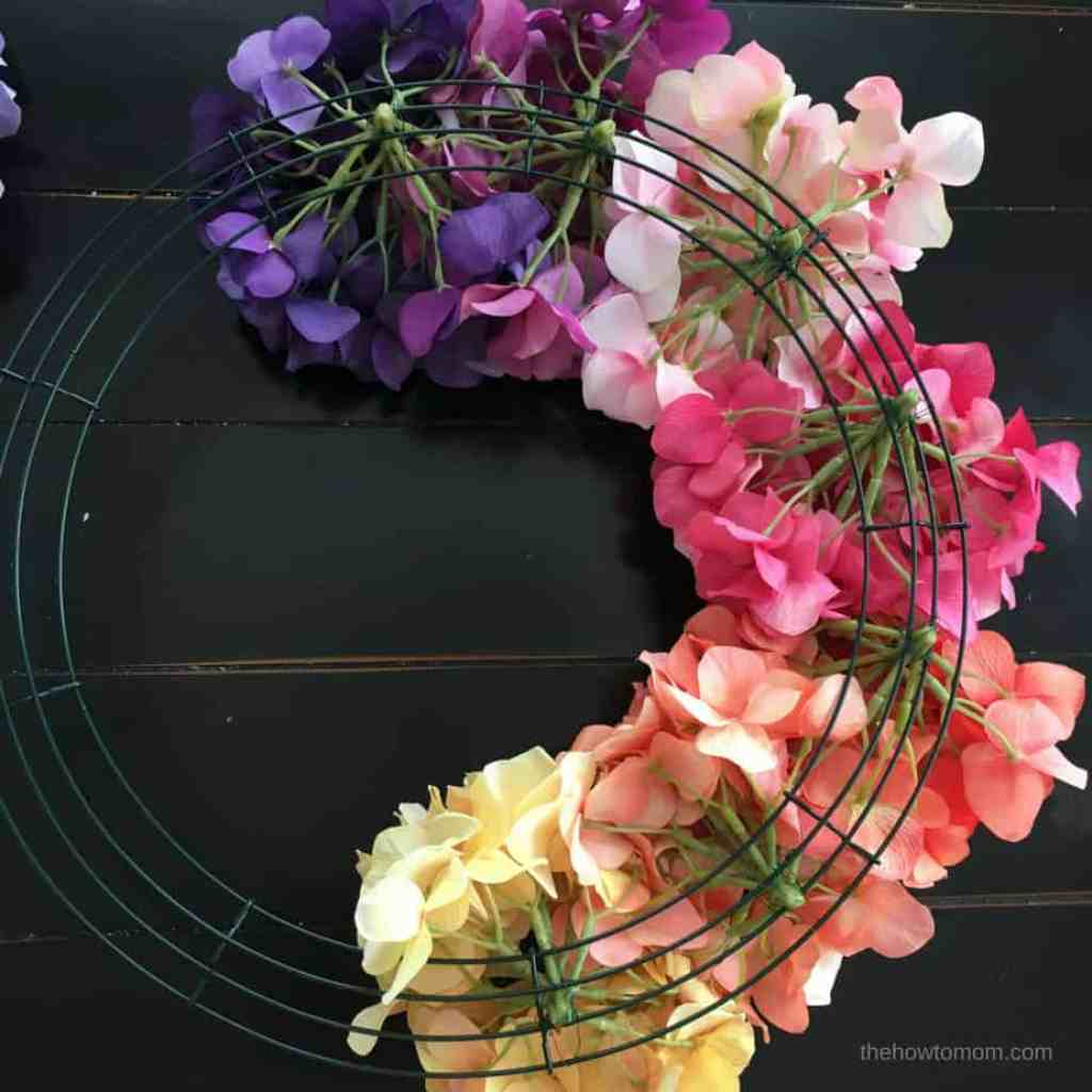 How to Make a Rainbow Hydrangea Wreath - using a wire wreath form and floral wire