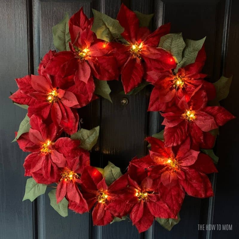 fairy lights on a red poinsettia wreath