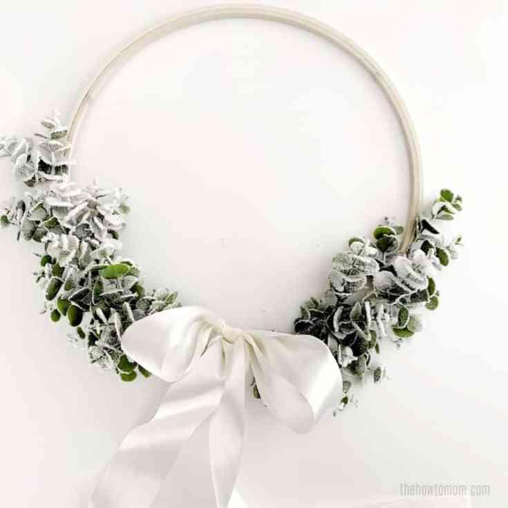 Eucalyptus wreath with flocking and white satin bow