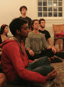 Kristen Skillman/The Hoya Students meditated at a Buddhist Meditiation Sanghra as part of iWeek Monday evening.