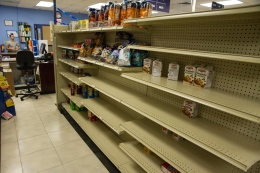 Shelves at Vital Vittles have been wiped clean in anticipation of the storm.