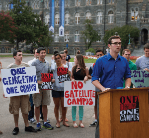 ALEXANDER BROWN/THE HOYA Nate Tisa (SFS '14) speaks at the One Georgetown, One Campus launch Sept. 8 protesting the proposed satellite residence.