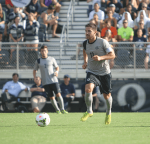 CHRIS GRIVAS/THE HOYA Senior midfielder and captain Tyler Rudy scored a stunning goal in leading the Blue and Gray to a 2-0 win over Harvard on Friday.