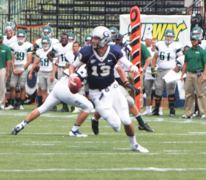 FILE PHOTO: CLAIRE SOISSON/THE HOYA Junior quarterback Kevin Nolan is set to continue his partnership with sophomore wide receiver Justin Hill against the Marist Red Foxes.