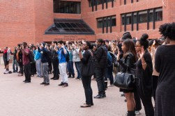 MICHELLE XU/THE HOYA Students gathered in Red Square at 12:28 p.m. on Tuesday for a silent demonstration organized by Georgetown's Black Leadership Forum in response to Monday's Ferguson verdict.