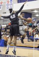 JULIA HENNRIKUS / THE HOYA Freshman guard DiDi Burton drove to the basket in a 69-61 win against Providence