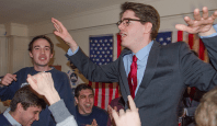 KATHLEEN GUAN FOR THE HOYA Joe Luther (COL '16), left, and Connor Rohan (COL '16) celebrate after the success of their satirical YouTopia campaign. The pair attempted to engage fatigued voters by criticizing the association for being out of touch.