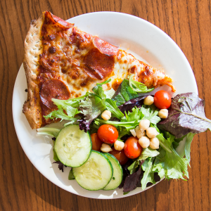 Instead of having three slices, try  having one to two slices of pizza with a salad on the side.
