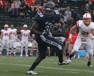 FILE PHOTO: ISABEL BINAMIRA/THE HOYA Senior running back and team captain Jo'el Kimpela recorded 838 rushing yards and 73 receiving yards and scored three touchdowns in the 2014 season.