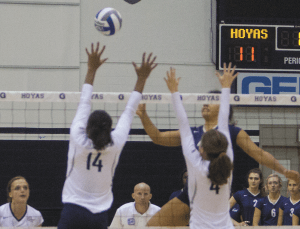 FILE PHOTO: ERICK CASTRO/THE HOYA Freshman middle blocker Symone Speech (left) leads Georgetown with 52 total blocks in the 2015 season and freshman setter Paige McKnight leads the team with 9.68 assists per set in the team's 20 matches.
