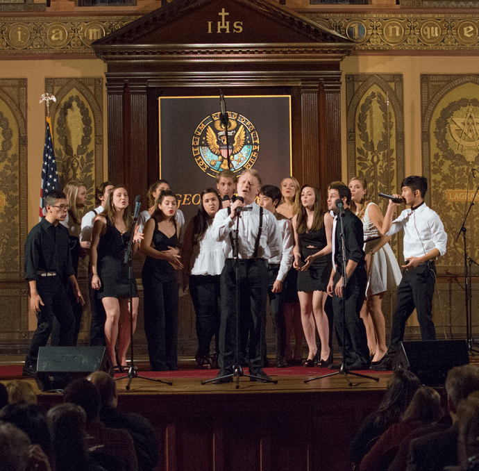 JINWOO CHONG/THE HOYA Zach Rego (MS B '16) performs with Superfood in Georgetown University's Gaston Hall, at the first weekend of the D.C. A Cappella Festival, hosted by the Phantoms and the Gracenotes.