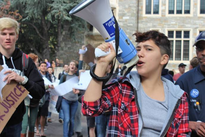 COURTESY GEORGETOWN SOLIDARITY COMMITTEE Members of the Georgetown Solidarity Committee, campus facilities workers and students marched from Red Square to President DeGioia's office to deliver a petition on workers' rights yesterday