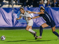 THE HOYA/Amber Kathryn Gillette| Graduate student forward Kyra Carusa outruns a UNC defender as she dribbles forward.