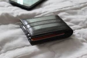 a wallet on the bed