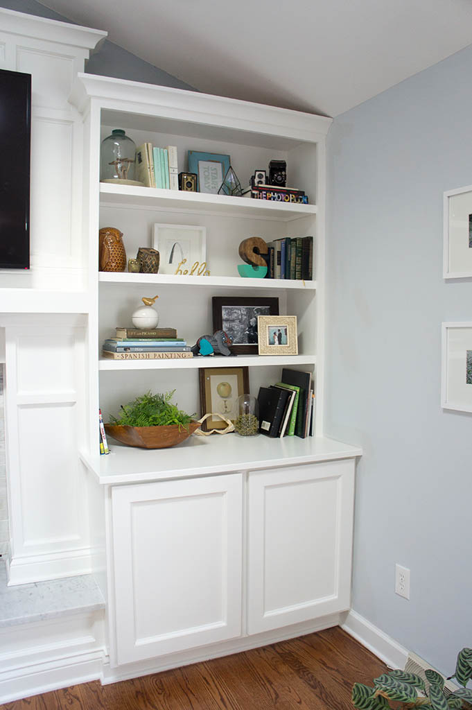 White wooden built-ins around fireplace.