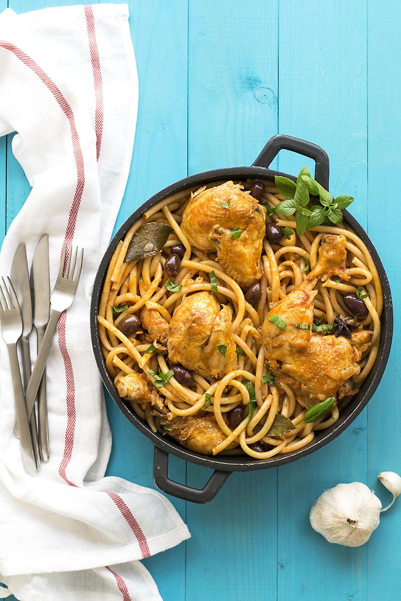 Whole chicken cacciatore stew with bucatini pasta