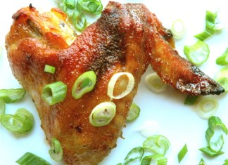 chicken wing garnished with scallion