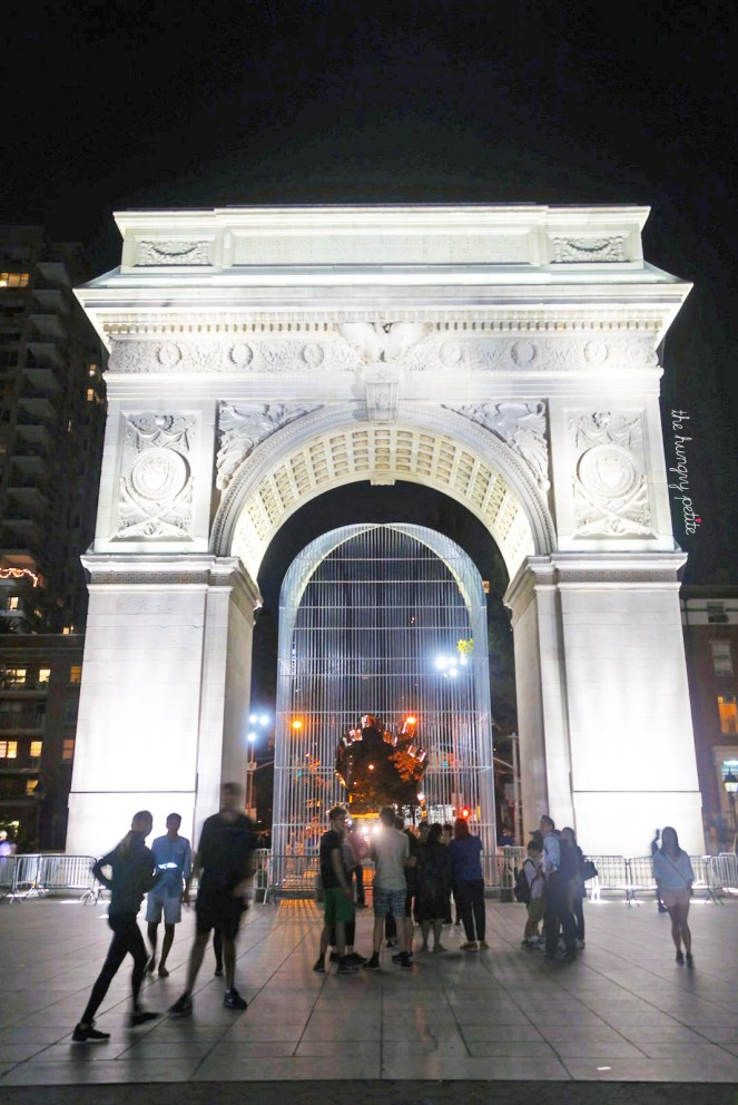 """Washington Square Park. Under the arch is Ai Weiwei's """"Good Fences Make Good Neighbors"""" (symbolizing the way we create divisions in cultures and nations)"""