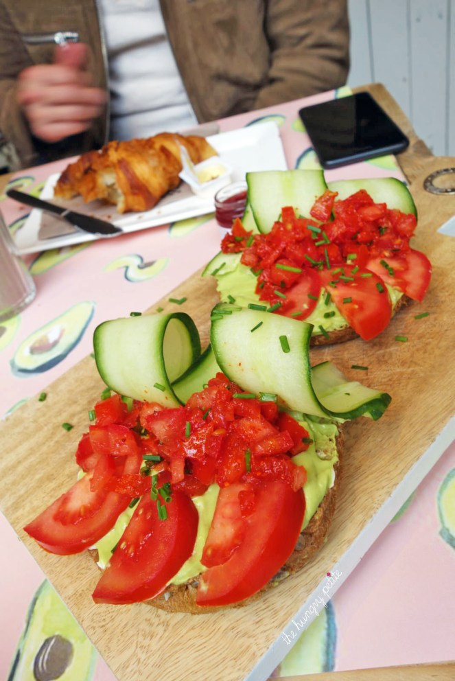 Sis in law's Avocado Smash - 2 toasts with avo, cucumber, tomato and homemade sauce