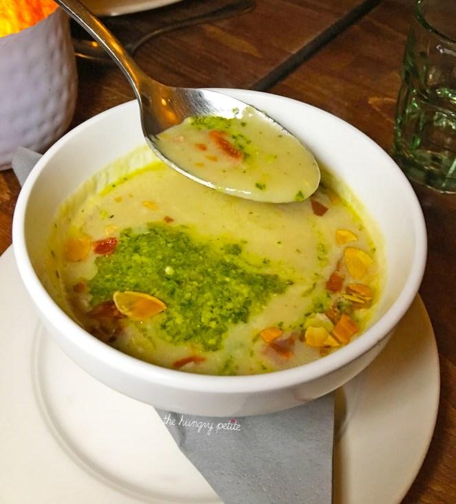 Soup of Jerusalem artichokes with crispy serrano ham, pesto and roasted almonds